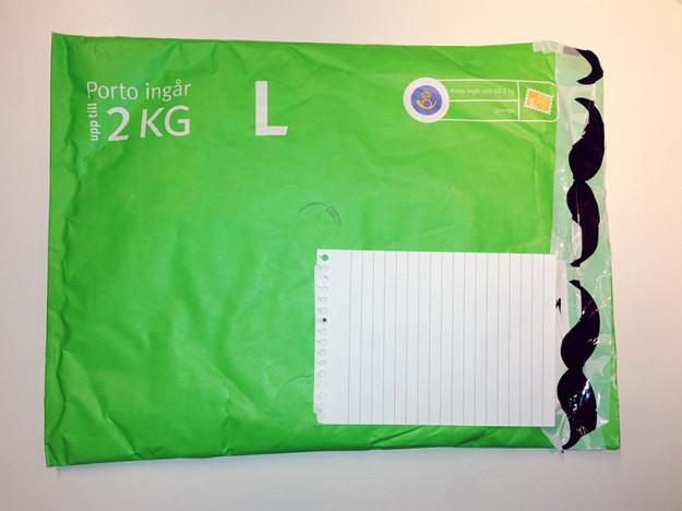 Grönt kuvert med extra tejp